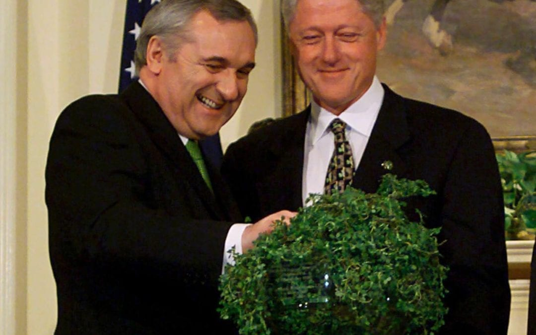 Bertie Ahern presents Bill Clinton with a bowl of shamrocks Photograph: Ron Sachs/Rex/Shutterstock